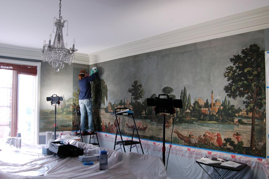 Fixing old wallpaper bubbles.